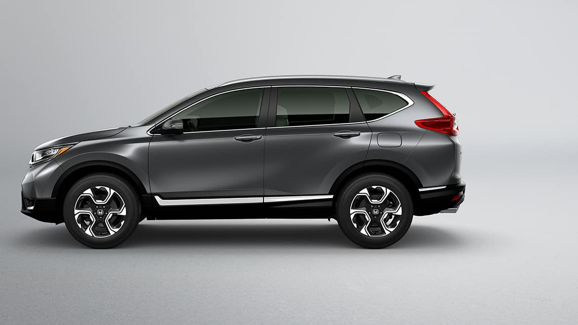 Side profile view of 2019 Honda CR-V Touring in Gunmetal Metallic.