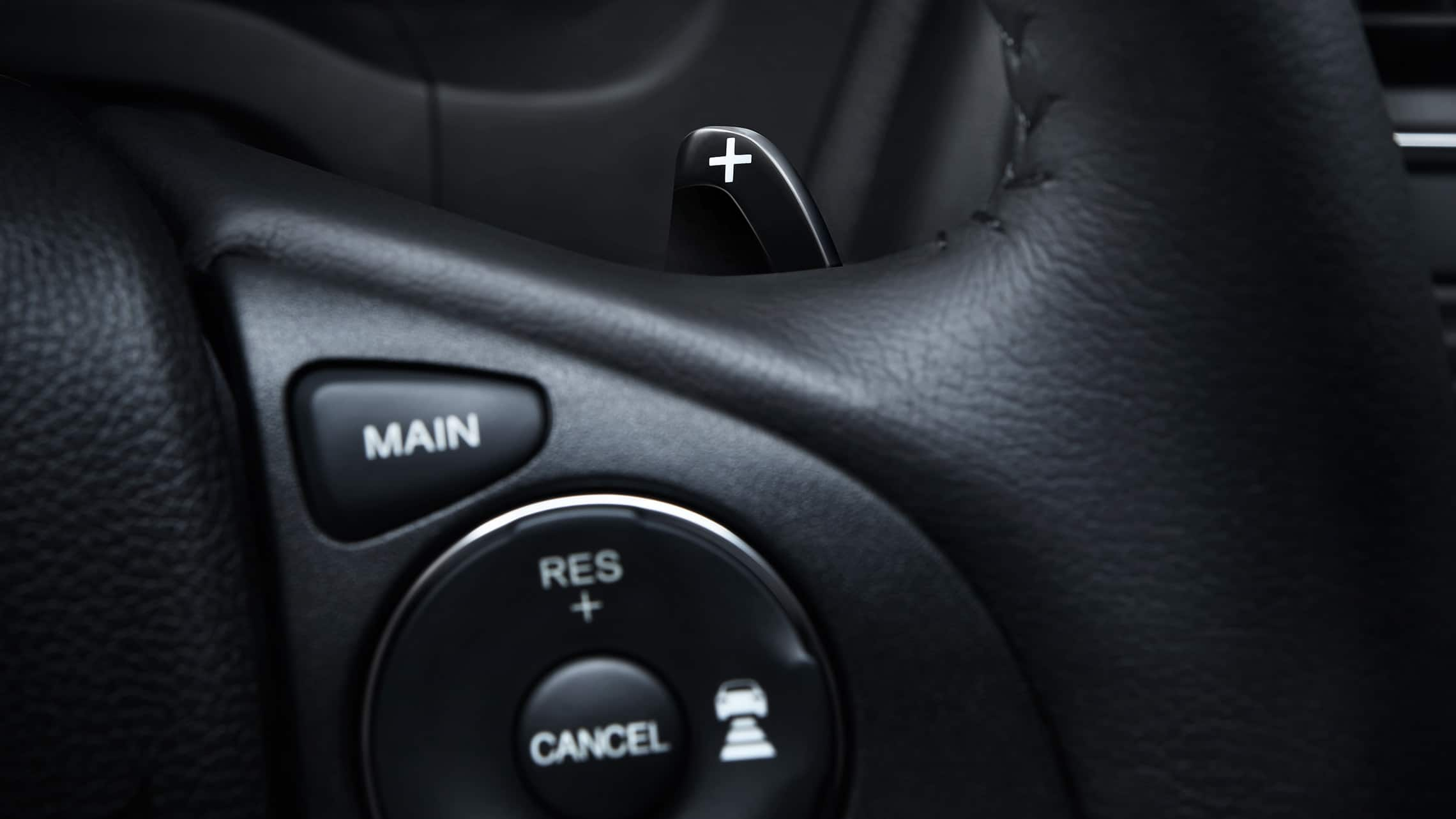 Paddle shifter detail displayed on steering wheel in the 2019 Honda HR-V Touring.
