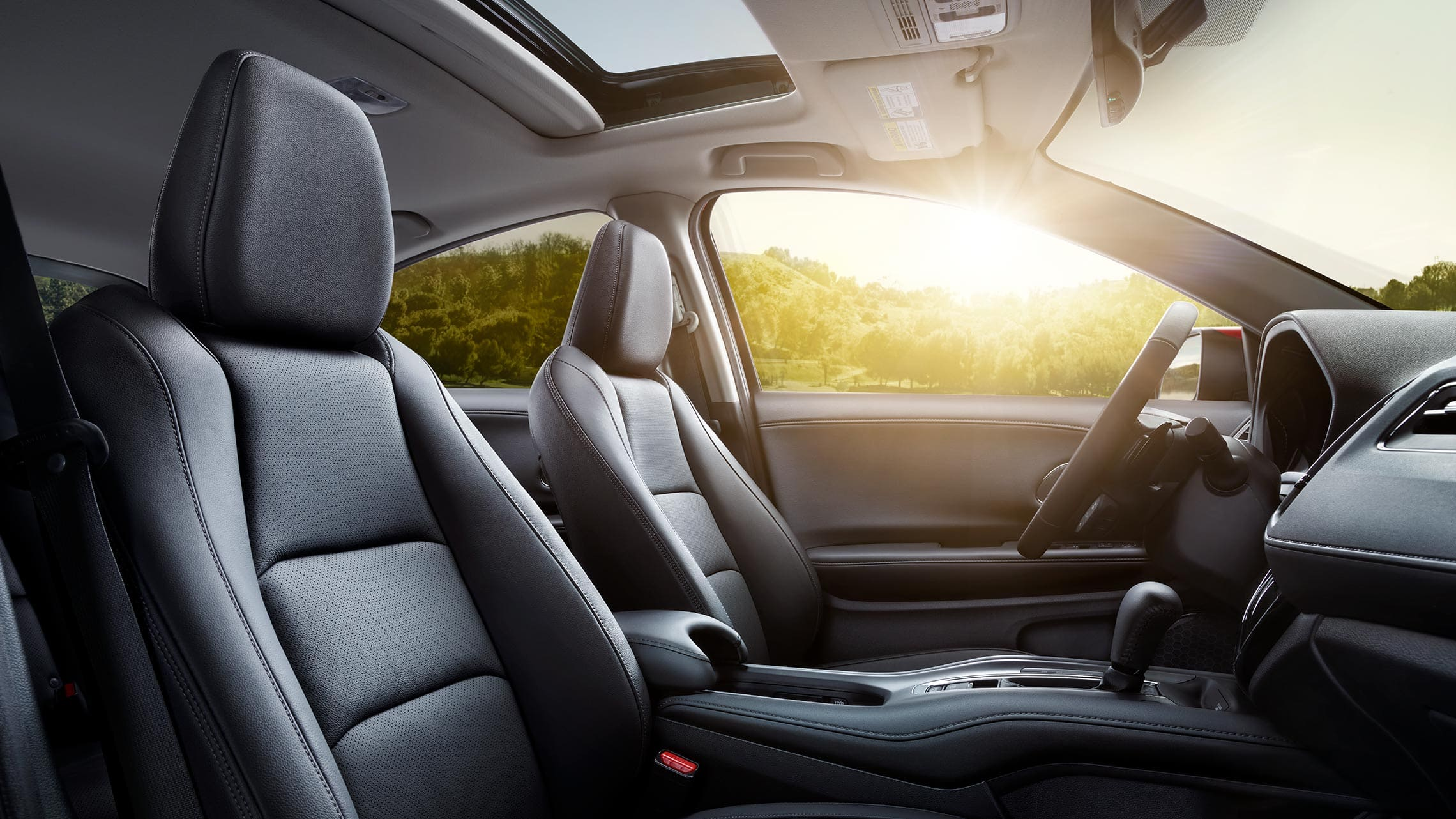 Interior passenger's side view of the 2019 Honda HR-V Touring seats in Black Leather.