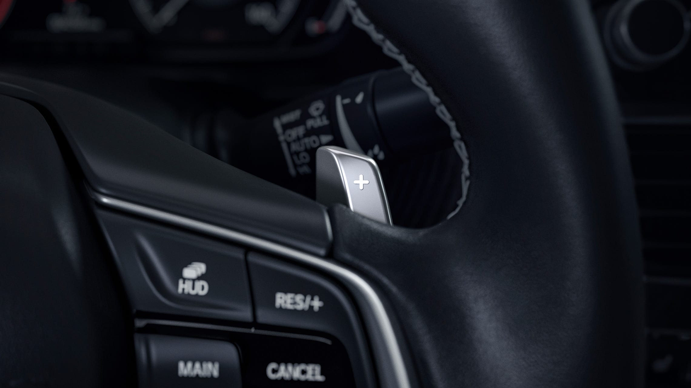 Steering wheel-mounted paddle shifter detail in the 2020 Honda Accord Touring 2.0T.