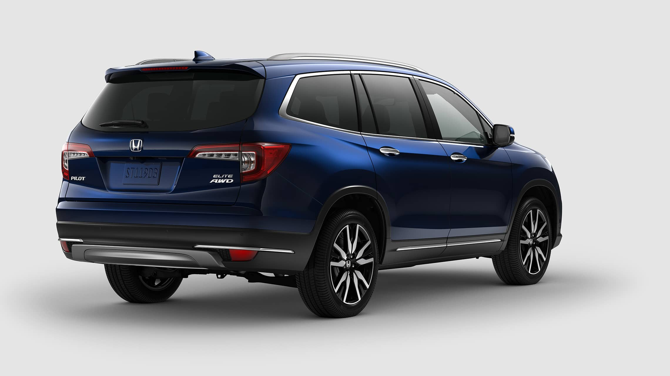 Rear 3/4 passenger-side view of 2021 Honda Pilot Elite in Obsidian Blue Pearl.
